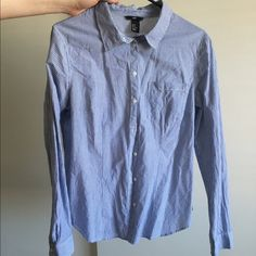 H&M button down shirt Button down shirt in blue and white stripes. Size 14. Worn only once. Just slightly wrinkled from being in my closet. Great shirt for work or dress up. H&M Tops Button Down Shirts