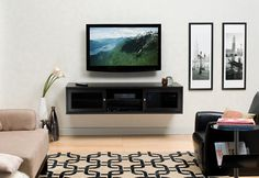 Wall Mount Flat TV Cabinets with Audio System in Black Finish between Picture Frames and Flower Hangings, 34 furniture & interior designs in Wall Mount Tv Cabinet Living Room Design gallery Wall Mounted Entertainment Unit, Wall Mounted Tv, Entertainment Centers, Bathroom Wall Cabinets, Tv Cabinets, Armoires Murales Tv, Floating Tv Shelf, Flat Panel Tv, Flat Tv