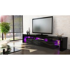"Let your home be more beautiful with the entertainment unit TV Stand. Helios flat screen tv stands is part of a modern style collection designed wooden tv stands to create and energetic atmosphere. Made of high quality MDF with colorful finishes entertainment stands. Its unique design black tv stand includes splayed legs and ring door holes. With 2 shelves and 3 doors there is space to store and display media items, books, pictures. Fits up to a Standard 80"" Screen TV, Modern tv stands for…"