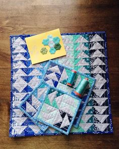 """The card reads """"enjoy"""" and I most certainly will!  Thank you @kbkreativ for this gander of geese. The colors are just what I hoped for and I was so excited to see this quilt I hoped was mine really was! @karie_twokwikquilters mark me down as happily received. I'm shipping out mine tomorrow morning. #blueberrykarie #blueberryparkminiswap #miniquilt #flyinggeese  #HTDreamNurseryContest"""