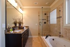 Bathroom Renovation Ideas for Your Home Decorating Ideas: Modern Bathroom Design With Dark Vanity Cabinets And Omicron Granite Countertop With Large Mirror Vanity And Vanity Sconces Plus Cozy Bathtub Also Kohler Shower Doors For Bathroom Renovation Ideas