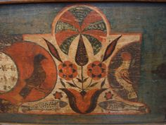 Stylized tulips with birds and fish on the side. From the Machmer auction at Pook and Pook.