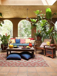 Ornate and eclectic furniture gives this patio a calm, relaxed vibe. Bright colors and patterns help to bring life and vibrancy to the space! http://www.bhg.com/home-improvement/porch/outdoor-rooms/outdoor-room-ideas1/?socsrc=bhgpin050715eclecticcharmporch&page=6