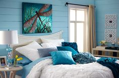 A blue lamp, blue pillows and blue walls inspire sweet dreams. Such a pretty bedroom and I love the dragonfly art over the bed! Dream Bedroom, Home Bedroom, Bedroom Decor, Pretty Bedroom, Bedroom Ideas, Master Bedroom, Dragonfly Decor, Dragonfly Painting, Blue Pillows