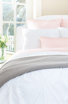 Soft, luxurious white pintuck bedding with a pop of coral. Pretty! Check out this website for luxury bedding at fabulous prices!