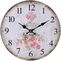 Shabby chic seinäkello toimii kodin jokaisella seinällä tyylikkäänä  ajannäyttäjänä. Rustiikkisessa kellotaulussa kaunis ruusukuviointi sekä  teksti ea487d6b57