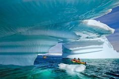 From the Smithsonian's List of 28 Places to Visit Before You Die: ANTARTICA  Magical and surreal describes Antarctica. As the southernmost continent, it is the coldest and windiest place on earth. And with virtually no rain and more than 95%  the landmass covered in ice, Antarctica is the world's largest desert. it also has no permanent human residents, thus making it the only continent with no government or political activity.  When visiting you feel as if you are on another planet.