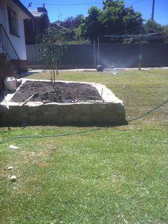 Concrete Block Raised Garden Beds. Sandstone Retaining Walls. Travertine  Paths. Paved Steps.