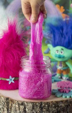 Pink slime jars with Troll hair lids are cute and fun at the same time.  I love sensory toys!