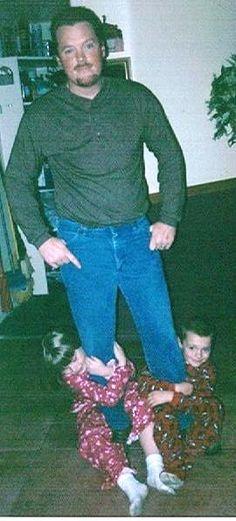 Daddy & Kids Hanging on Leg  ~K.B.C.