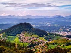 Ootys-view-from-the-doddabe  The main attractions for honeymooners are cascading waterfalls, lush greenery, curvaceous hill trails and pristine beauty.