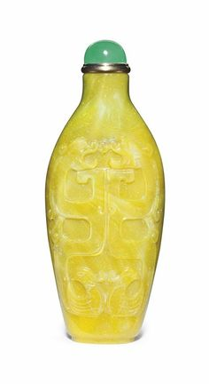 A carved yellow glass snuff bottle, Imperial, probably Palace Workshops, Beijing, 1780-1850