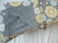 Charcoal minky baby blanket in gray with bright yellow and light gray flowers. $27.50, via Etsy. LOVE