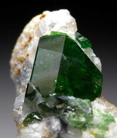 GEM, glassy green chrome Dravite set in matrix. These are rare to find in matrix and much rarer still to find in a such brightly colored, transparent crystal. Crystal is 1.1cm in size and so clear you can see right through it in parts. It also has sharp faces and great glassy luster. A rarity.   From Marin Mineral      via   Tina Rudnik