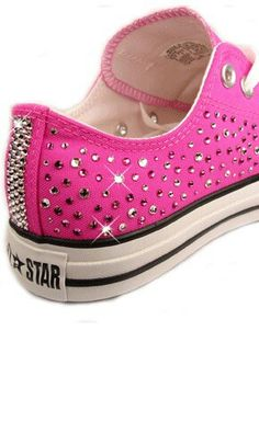 Pink converse with crystals.