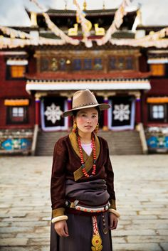 Tibetan women are famous for their gorgeous outfits, both traditional and stylish.  I took this photo in Sichuan Province, China, in September.