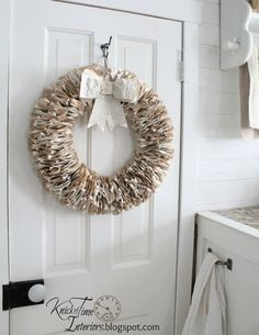 Book Page Wreath by http://knickoftimeinteriors.blogspot.com/ an interesting folded paper technique.
