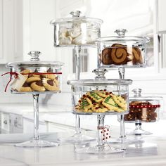Wide glass containers on footed pedestals for cookies and snacks