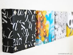 Cover shoebox lids with fabric or paper = instant wall art