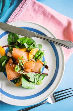 Smoked salmon salad on blue and white plate, seen from above. by Darren Muir
