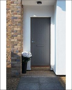 Photographic Print of Grey board front door in a contemporary house - with flowers from Arcaid Images by Media Storehouse, http://www.amazon.co.uk/dp/B001RYN4EC/ref=cm_sw_r_pi_dp_MXj7qb1CAG27A