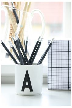 Desktop, Cup with letter A designed by Arne Jacobsen