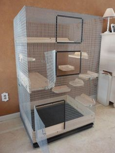 Large, spacious mesh and wood chinchilla cage.
