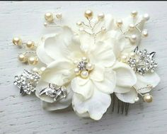 Check out this item in my Etsy shop https://www.etsy.com/listing/446529664/bridal-hair-comb-wedding-comb-ivory-comb