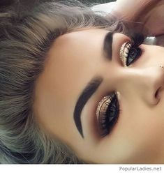 Gold eye makeup with glitter