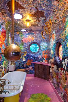 Yellow Submarine Bathroom  Granny's Grannyboot is a house that features rooms designed and worked on by various artists. Each room has a particular theme and look where the artists are free to run wild. This particular room, the bathroom is entitled the 'Gaudi Submarine'.