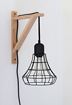 DIY Cage Light Sconce A clever idea using the Threshold Industrial Plug-In Pendant and an IKEA EKBY VALTER Bracket. How to from Nalle's House.