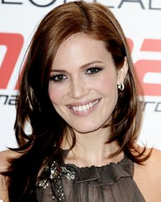 Mandy Moore - Gradual, Face Framing Layers - Mid-length cut with tons of piecey layers starting at the chin; because the ends are so thinned, it is an ideal look for women wanting to infuse lightness into thick, dense strands