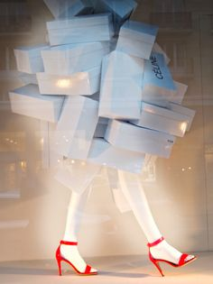 Parisian Window display via thewildfleur.com -- smart use of shoe boxes
