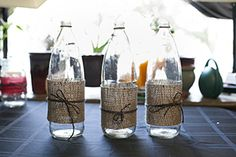 tall glass jars with burlap and twine, for centerpieces to hold flowers