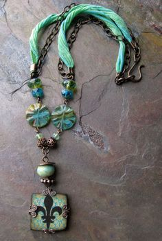 By kristy abner.  .Love the color and the combo of chain and ribbon. A great easy to wear fun piece.
