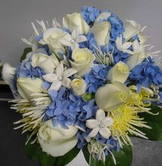 Exciting Blue and White bouquet designed by Larry Hoogasian includes hydrangea, white roses, stephanotis, needlepoint mums and more.