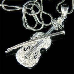 PERFECT CHRISTMAS GIFT FOR MUSIC FANS, INSTRUCTOR, TEACHER OR STUDENT!!    You are getting a Crystal Clear VIOLIN with Bow Pendant inlayed with Swarovski