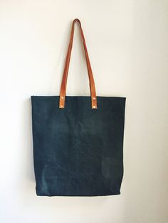 Waxed canvas tote with leather straps