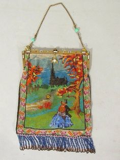 Antique micro beaded scenic purse Jeweled and enameled frame 8 wide Czech Beautiful beading in wonderful condition . Couple walking toward a castle