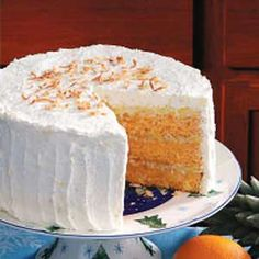 Hawaiian Sunset Cake Recipe -This three-layer orange cake is pretty enough for company, but it's so simple to fix that you'll find yourself making it all the time. A boxed mix keeps it convenient while the pineapple-coconut filling makes it a crowd-pleaser. -Kara De la vega, Suisun City, California