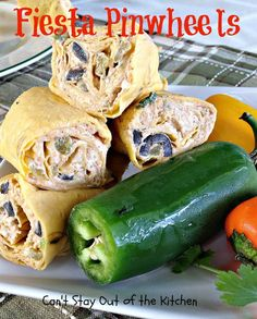 Fiesta Pinwheels have a cream cheese base seasoned with taco seasoning and garlic powder, then add olives, green chilies, green onions, cheese and salsa.