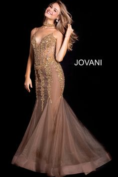 b248a58b6ea Floor length mermaid taupe gold embellished tulle prom dress with a choker  features spaghetti straps plunging. jovani.com