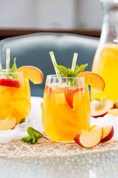 Peach Mango Sangria - White wine sangria made with fresh peaches and mangoes, nectar, and added liquor for a delicious summer drink. Peach Sangria Recipes, Mango Sangria, Mango Drinks, Cantaloupe Recipes, Radish Recipes, Mango Recipes, Summer Drinks, Peach Wine, White Wine Sangria