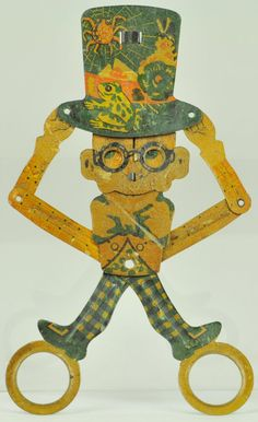 HAROLD LLOYD SCISSOR TOY  Die-cut tin scissor-hand held and operated toy with great lithography