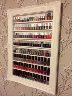 Use beautiful frames as clever nail varnish storage