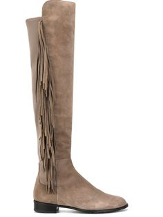 Shop Stuart Weitzman fringed boots  in Spinnaker 101 from the world's best independent boutiques at farfetch.com. Shop 300 boutiques at one address.