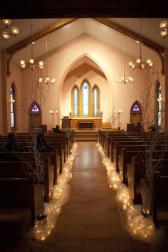 Ohio Village Church. Columbus Ohio Weddings. Willow Branches lined with lights make an elegant pathway.