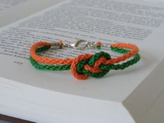 double figure eight knot bracelet unisex kumihimo rope bracelet in orange and green lenght adjustable adult jewelry Unisex, Fabric Swatches, Orange, Paracord, Bracelets, Jewelry, Ideas, Creative Products, Knot