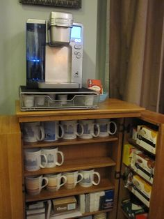 Coffee Bar... this is actually my sister's DVD storage cabinet which we converted into a coffee/tea station.  Works beautifully.  Store all the teabags, coffee, creamer, etc. in the doors; plenty of room for mugs, etc.  Voila!