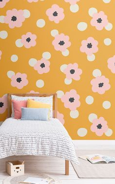 Style a fun themed space that's full of stylish colour with this cute floral wallpaper, a cool retro daisy design.